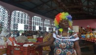 Any trick is fair game when trying to attract customers in the Point-A-Pitre market, as this woman's colourful wig so joyfully demonstrates. Her extravagant earrings and larger-than-life personality probably don't hurt either, at least unless the customers have a tendency to be intimidated. #Pointe-A-Pitre / Guadeloupe